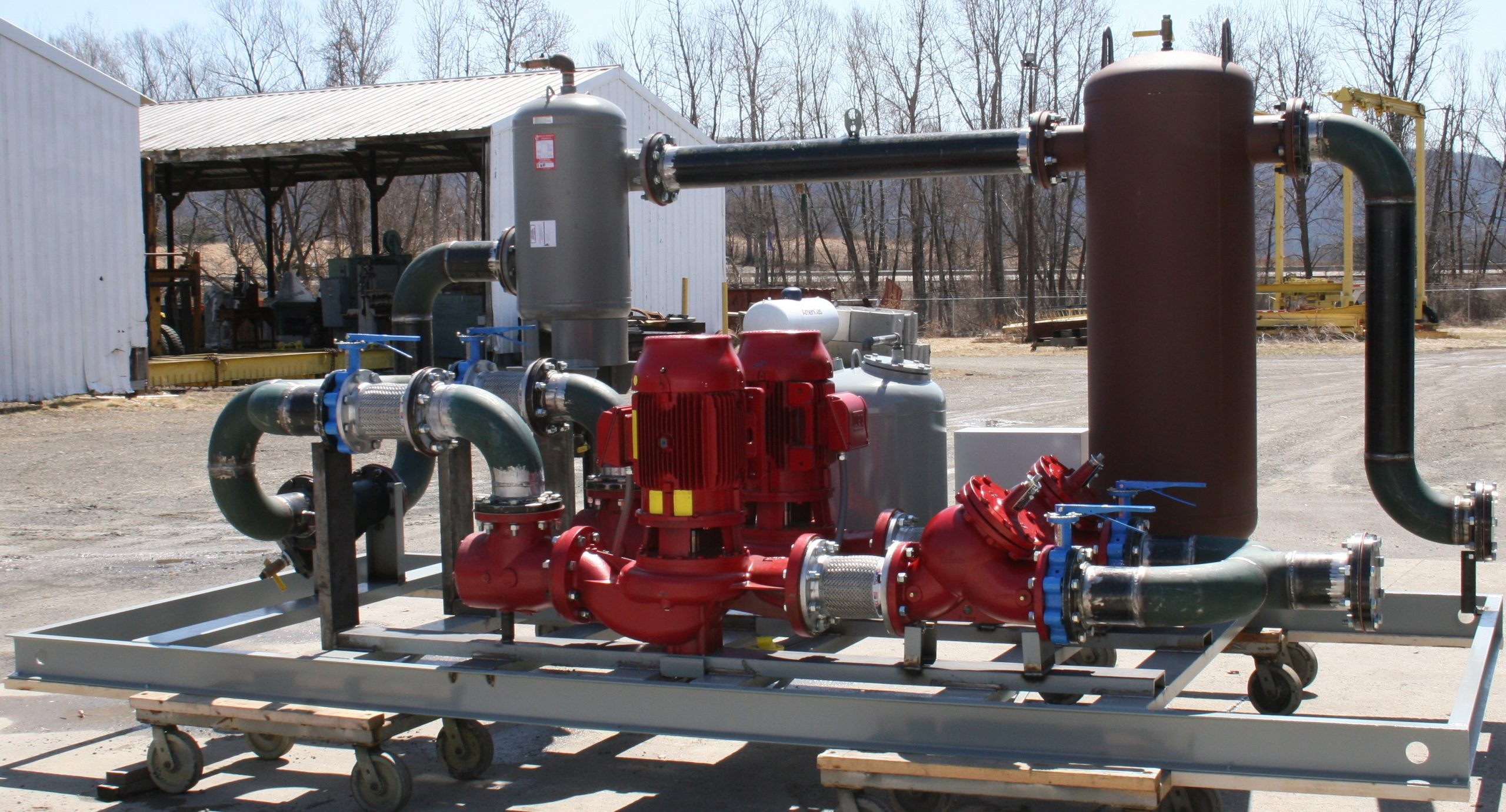 Turn-key pump skid assembly for connection to chiller machine. Application is for a gas field compressor station.